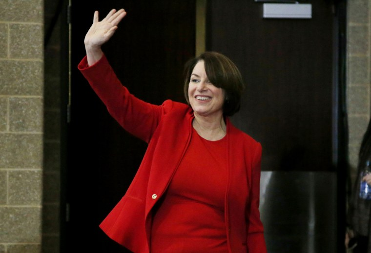 Image: Sen. Amy Klobuchar, D-Minn., waves as she arrives to speak to the Scott County Iowa Democrats on Jan. 25, 2020.