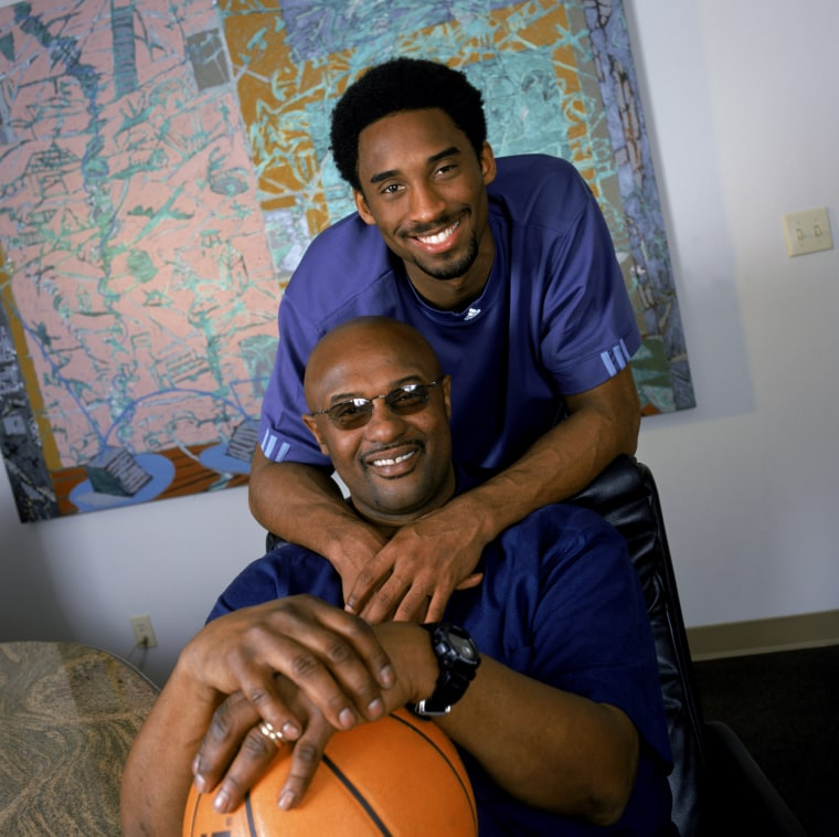 Image: Kobe Bryant poses for a photo with his father, former NBA player Joe Bryant, in Los Angeles in November 2000.