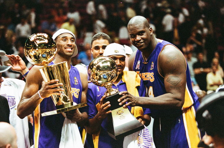 Image: Kobe Bryant, Lindsey Hunter, and Shaquille O'Neal celebrate after Game Four of the NBA Finals against the New Jersey Nets in 2002.