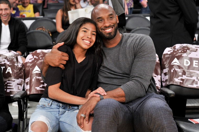 Image: Kobe Bryant hugs his daughter, Gianna, during a Los Angeles Lakers game on Nov. 17, 2019.