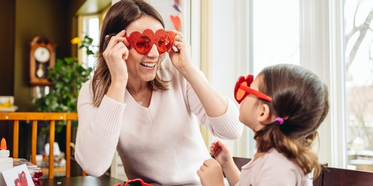 Mother and young daughter crafting for Valentine's Day