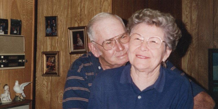 One of the photographs featured in the ad shows the man hugging his late wife, Loretta.