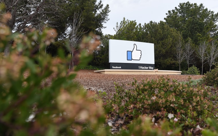 Image: A sign is seen at the entrance to Facebook's corporate headquarters