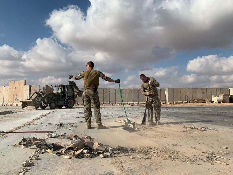 Image: U.S. soldiers clearing rubble at Ain al-Asad military airbase in the western Iraqi province of Anbar in Iraq on Jan. 13, 2020.