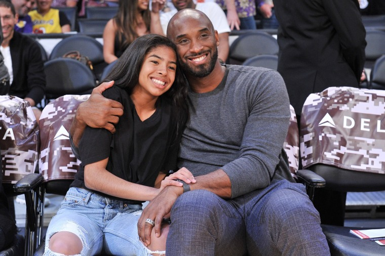 Image: Kobe Bryant and his daughter Gianna Bryant attend a basketball game between the Los Angeles Lakers and the Atlanta Hawks at Staples Center
