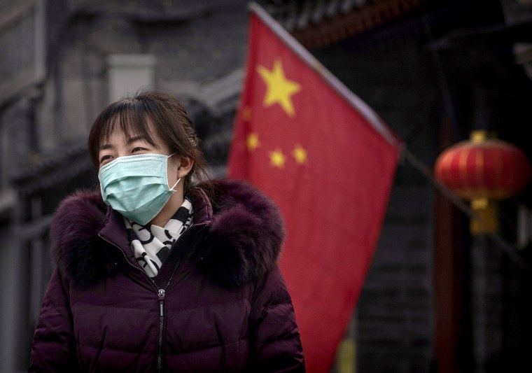 Image: A woman wears a mask to protect against a coronavirus outbreak in Beijing on Jan. 26, 2020.