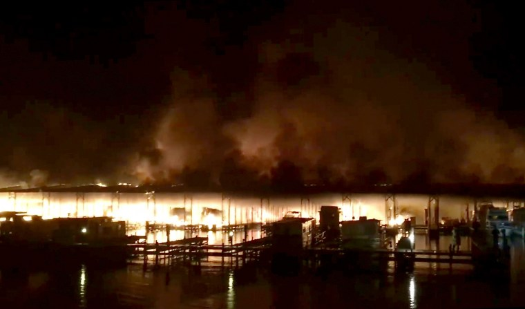 Image: A fire burns on a dock where at least 35 vessels were destroyed by a fire in Scottsboro, Ala., on Jan. 27, 2020.