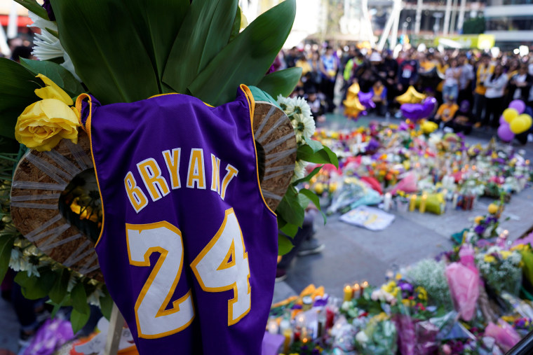 Image: Fans of NBA basketball star Kobe Bryant pay their respects at a memorial outside the Staples Center at L.A. Live in Los Angeles