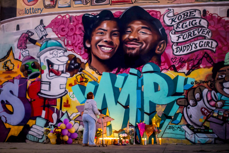 Image: A woman looks at a mural by artists Muck Rock and Mr79lts of Kobe Bryant and his daughter, Gianna, after they were killed in a helicopter crash in Los Angeles on Jan. 27, 2020.