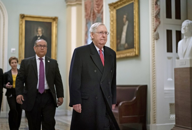 Senate Majority Leader Mitch McConnell arrives for the impeachment trial of President Donald Trump on Jan. 28, 2020.
