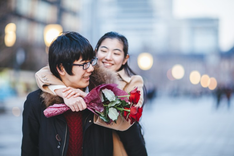 Young couple dating in street