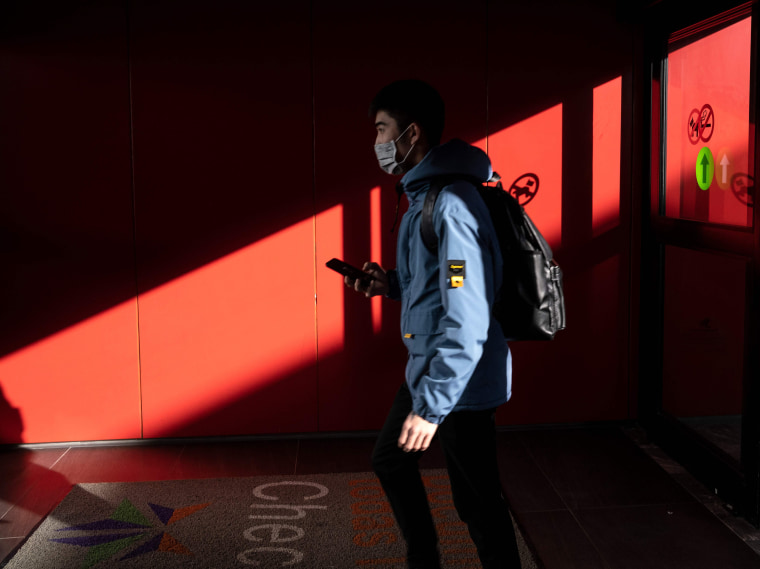 Image: A passenger from China's Hainan Airlines from Beijing walks out of the arrivals gate at the Abelardo L. Rodriguez International airport in Tijuana