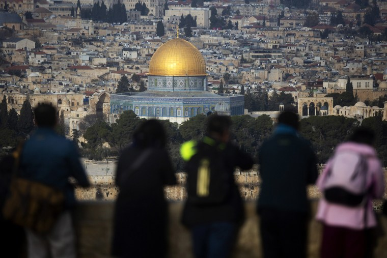 Image: Tourists look out at a view of the Old City of Jerusalem