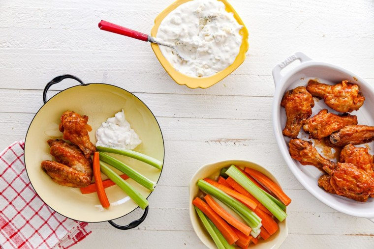 Looking to lighten up your Super Bowl calorie load? Make these traditional buffalo wings in the air fryer.