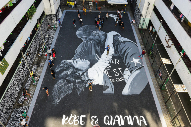 Image: A large drawing shows basketball legend Kobe Bryant and daughter Gianna at a basketball court in Taguig, south of Manila