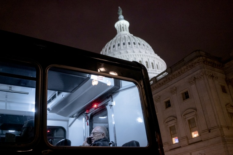 Image: Attorney Alan Dershowitz on a bus leaving the Capitol on Jan. 27, 2020.