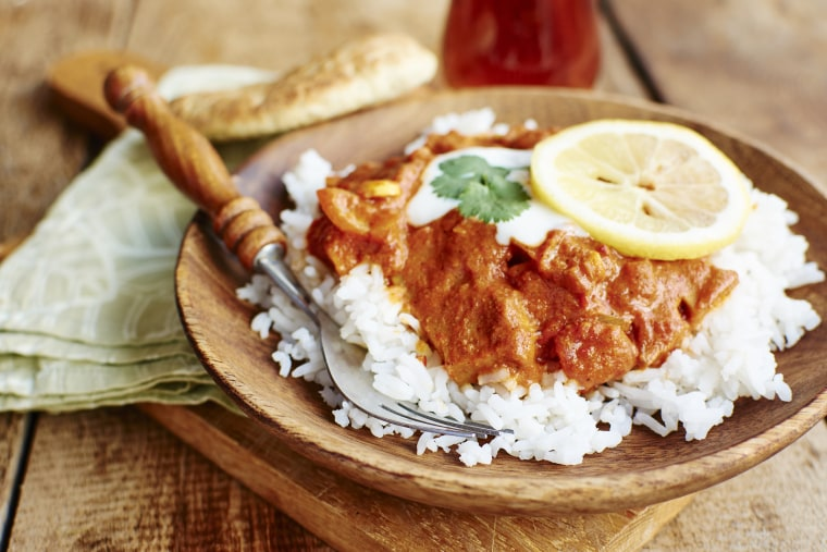Image: Seitan Tikka Masala on rice with soy yogurt and served with paratha bread