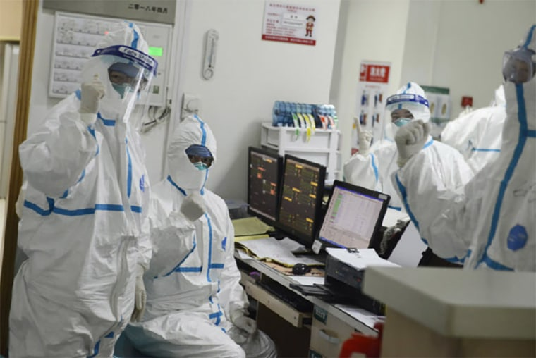 Image: The official Weibo page for Wuhan Central Hospital posted a photo on January 22 appearing to show medical staff in hazmat suits making a sign of resolve.