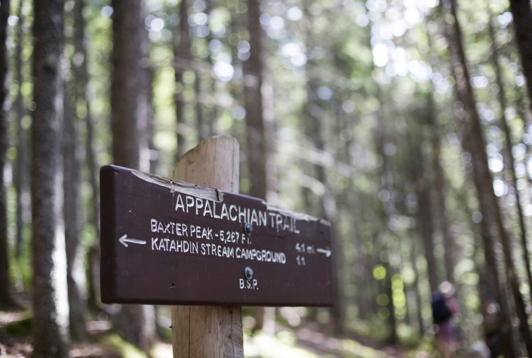 Image: A sign post directs hikers on the Hunt Trail, a section of the Appalachian Trail and popular route to Baxter Peak on Mt. Katahdin.