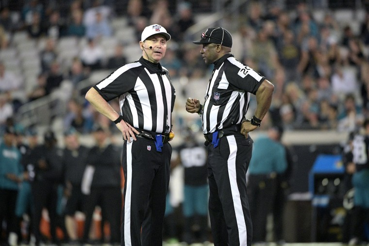 Referee Brad Allen, left, and umpire Barry Anderson (20) talk on the field during the second half of an NFL football game against the Indianapolis Colts on Dec. 29, 2019, in Jacksonville, Fla. Umpire Anderson will be part of the Super Bowl officiating crew.