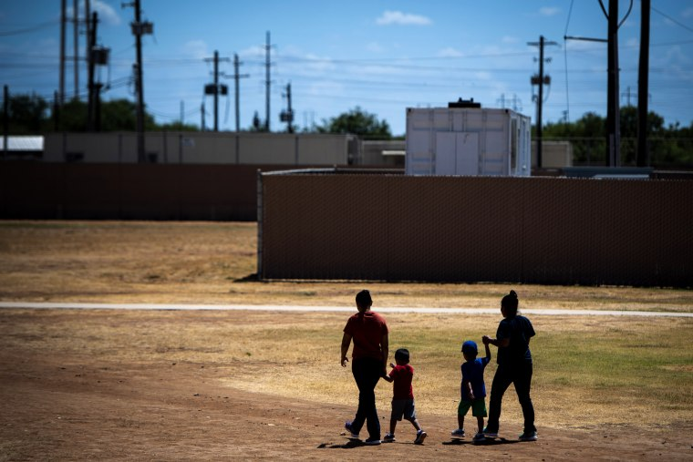Image: Migrant women and children walk at the South Texas Family Residential Center in Dilley, Texas, on Aug. 23, 2019.