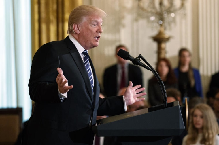 Image: Trump speaks during an event in the East Room of the White House