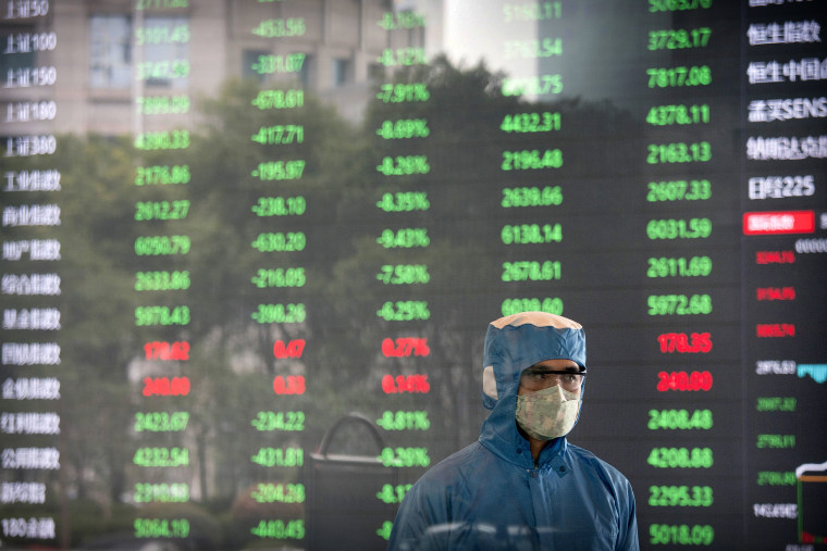 Image: A worker wearing a protective suit inside the lobby of the Shanghai Stock Exchange on Feb. 3, 2020.