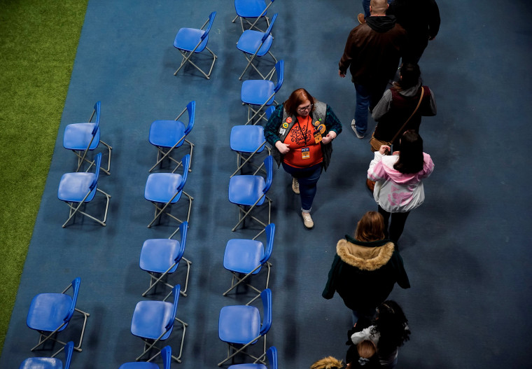 Image: People take part in a Caucus at Drake University in Des Moines