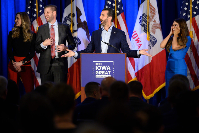 """Image: Donald Trump Jr. speaks with his brother Eric and wife Lara, as well as his girlfriend Kimberly Guilfoyle during a """"Keep Iowa Great"""" press conference in Des Moines"""