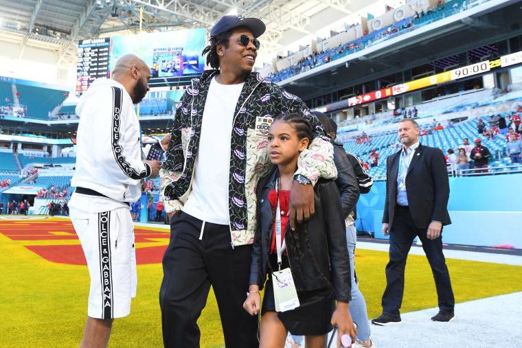 Image: Rap artist Jay-Z and his daughter Blue Ivy arrive at Super Bowl LIV at Hard Rock Stadium.