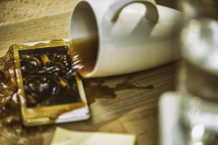 Image: Coffee spilling over smartphone