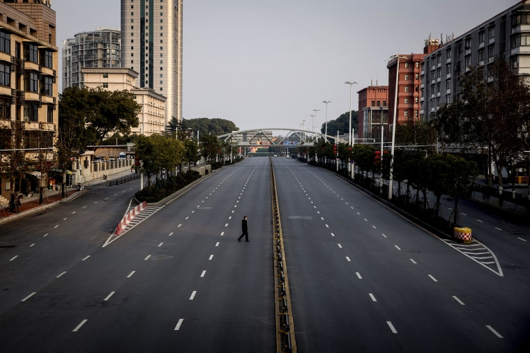 Image: A man crosses an empty highway in Wuhan, China, on Feb. 3, 2020. The coronavirus, which has now spread to several countries, originated in Wuhan.