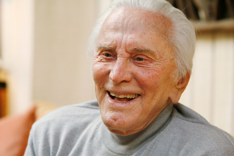 "Image: Actor Kirk Douglas, 90, is photographed during an interview about his life, film career and his new book ""Let's Face It,"" at his home in Beverly Hills, California"