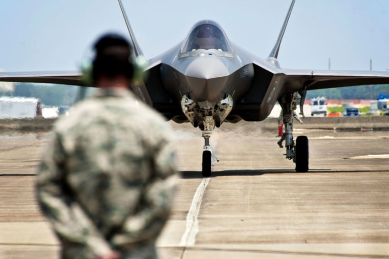 In this photo taken on July 14, 2011 and released by U.S. Air Force, Tech. Sgt. Brian West watches an F-35 Lightning II approach for the first time at Eglin Air Force Base, Fla. (AP Photo/U.S. Air Force, Samuel King Jr.)