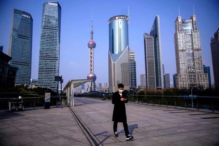 Image: A man wearing a protective mask walks through the financial district in Pudong, China, on Feb. 3, 2020.