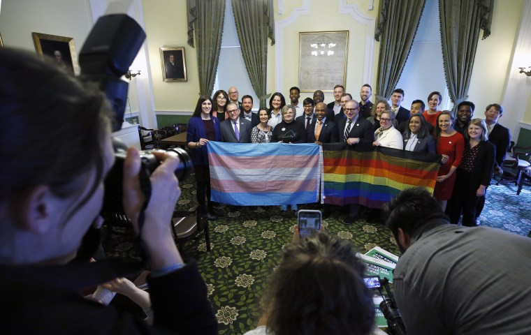 Image: Supporters of SB 868 gather for a group photo after a press conference ahead of the floor votes on SB 868, the Virginia Values Act. The event was held in the Jefferson Room of the State Capitol in Richmond,