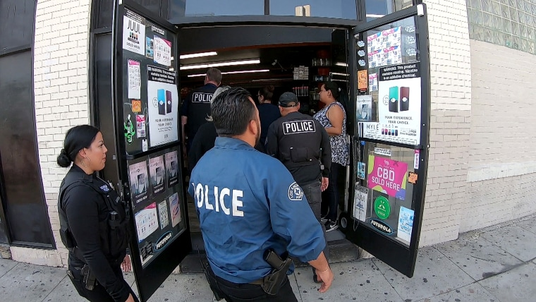 Police descend on a suspected unlicensed marijuana shop in Los Angeles.