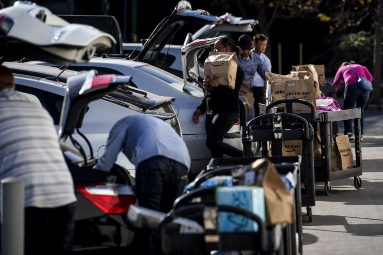 Image: Contractors working for Amazon Flex load packages onto vehicles for delivery in San Francisco on Oct. 30, 2018.