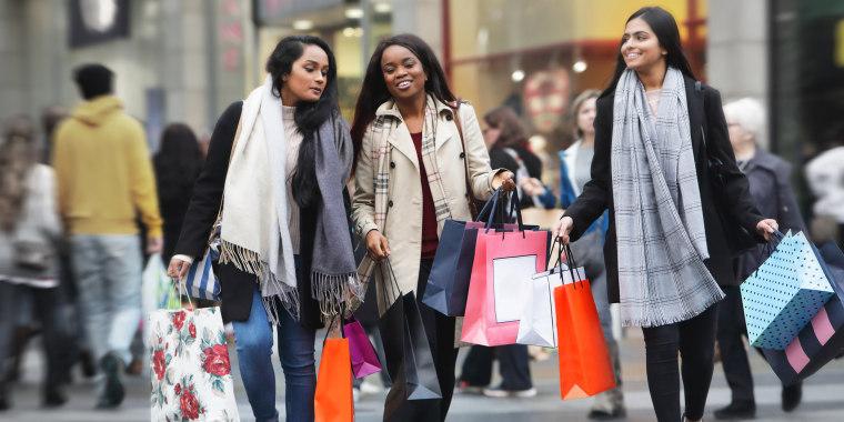 Three young women in town shopping