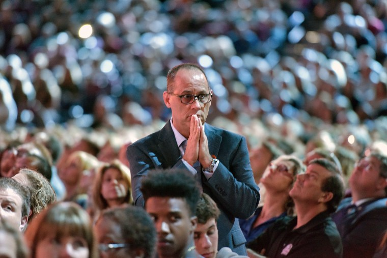 Fred Guttenberg watches a monitor honoring the 17 students and teachers who were killed at Douglas High School, during a CNN town hall meeting, at the BB&T Center, in Sunrise