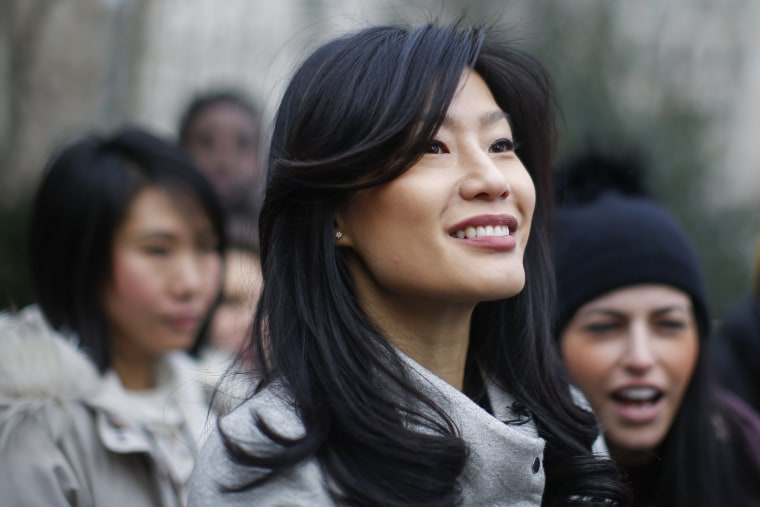 Image: Evelyn Yang, wife of Democratic presidential candidate Andrew Yang, attends a rally before the Women's March in New York on Jan. 18,. 2020.