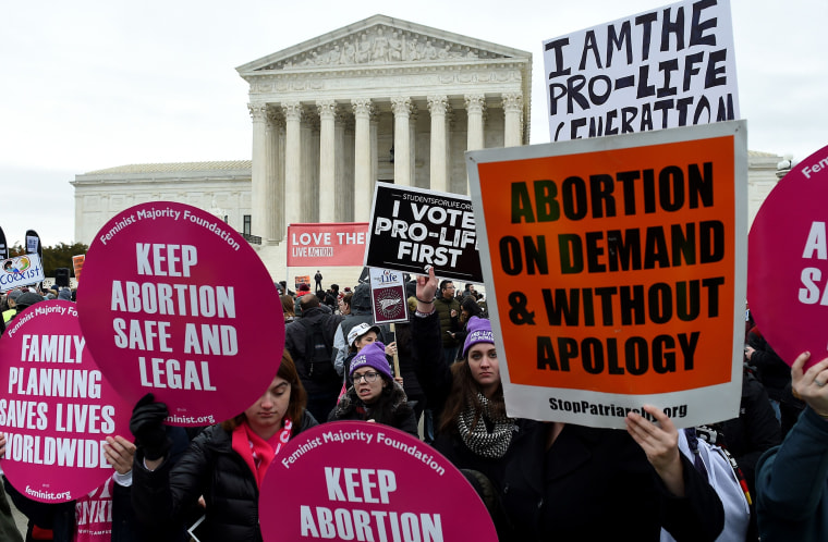 Pro-choice and pro-life activists demonstrate in front of the the Supreme Court during the 47th annual March for Life on Jan. 24, 2020.