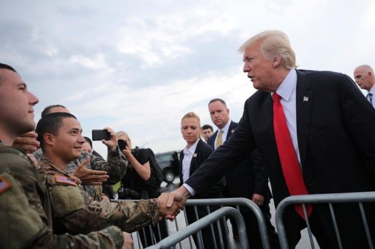 Image: U.S. President Donald Trump greets members of the military as he arrives at Raleigh County Memorial Airport in Beaver, West Virginia, U.S.
