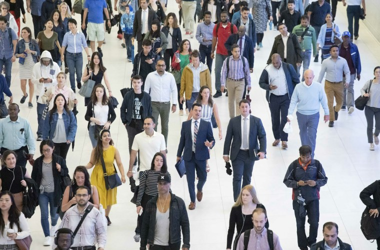 Commuters walk through a corridor in the World Trade Center Transportation Hub on June 21, 2019 in New York.