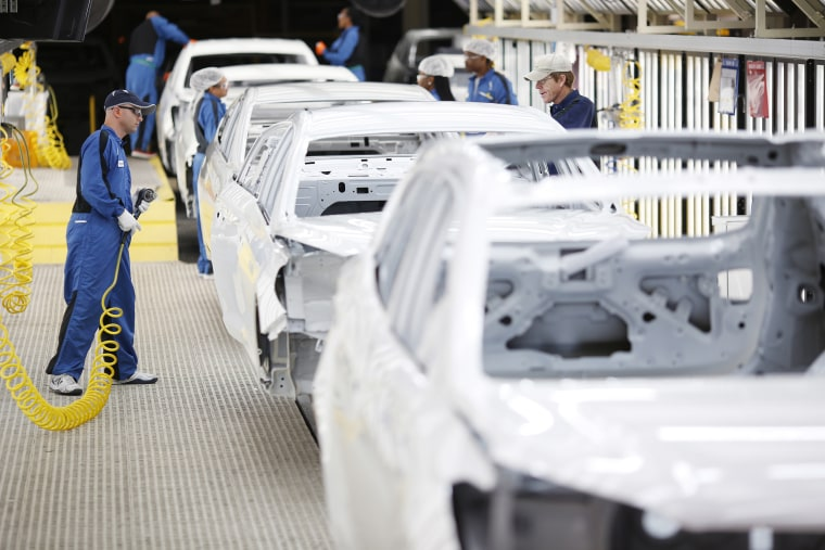 Employees inspect vehicle frames inside the paint shop at the Hyundai Motor manufacturing facility in Montgomery,