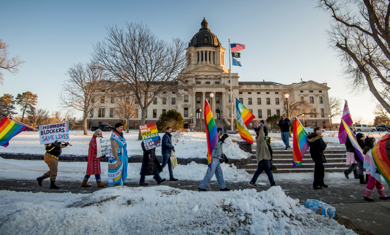 Image: LGBTQ advocates protest outside of the South Dakota Capitol before a bill banning gender-affirming care for trans youth was blocked.