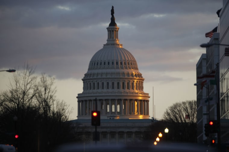 The dome of the U.S. Capitol Building is seen as the sun sets on Capitol Hill.