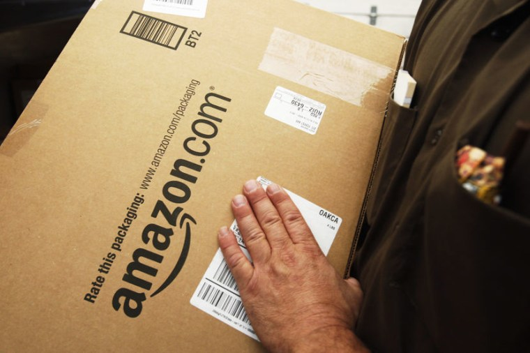 An Amazon.com package is prepared for shipment by a United Parcel Service (UPS) driver in Palo Alto, Calif.
