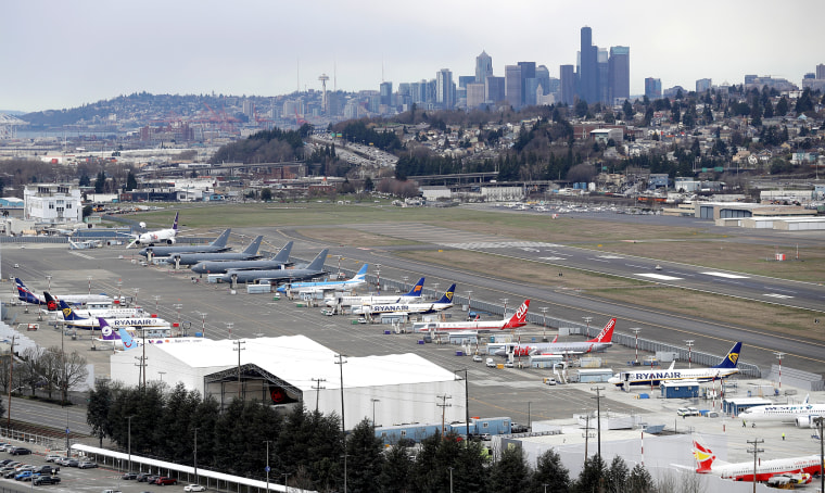 Airplanes at a Boeing facility at King County International Airport, also known as Boeing Field, with downtown Seattle in the background in February 2018.