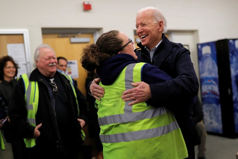 Image: Democratic 2020 U.S. presidential candidate and former Vice President Joe Biden hugs a school bus driver during a visit at a bus garage while campaigning in Nashua, New Hampshire U.S.